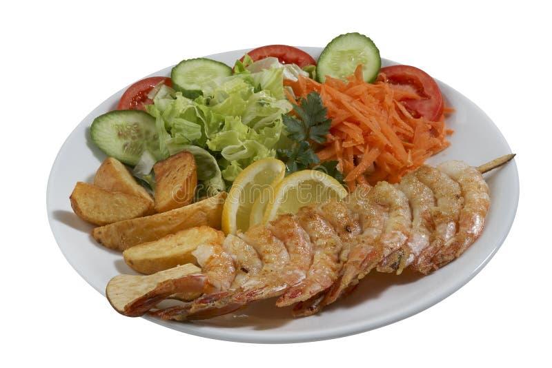 Chiche-kebab de poissons, poisson embroché avec des légumes photo libre de droits
