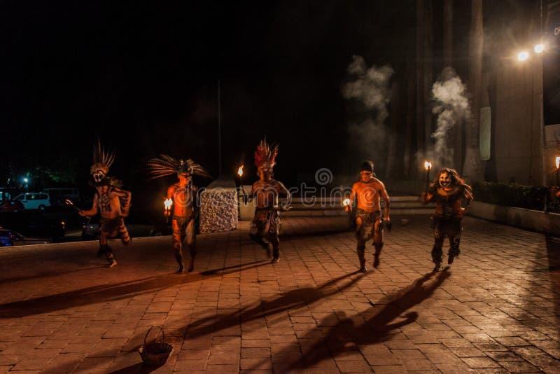 CHICHEN ITZA, MEXICO - FEB 25, 2016: Native mayan dancer performance near Chichen Itza ruin royalty free stock photo