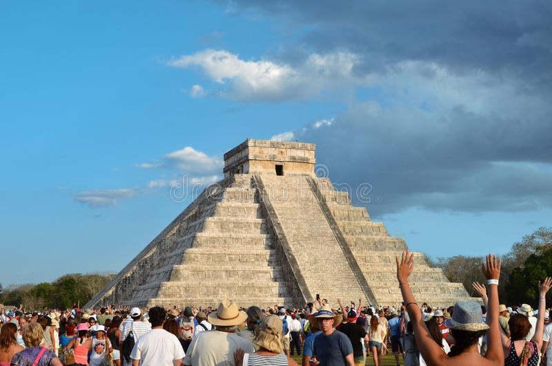 CHICHEN ITZA, MEXICO - MARCH 21,2014: Tourists watching the feathered serpent crawling down the temple Equinox March 21 2014.  royalty free stock photography