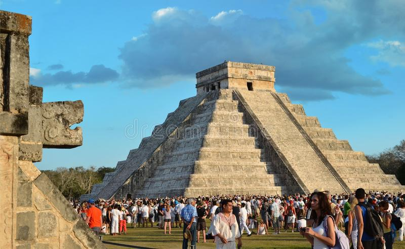 CHICHEN ITZA, MEXICO - MARCH 21,2014: Tourists watching the feathered serpent crawling down the temple Equinox March 21 2014.  stock photos