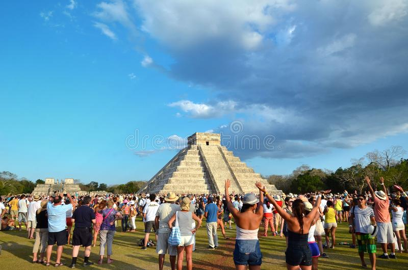 CHICHEN ITZA, MEXICO - MARCH 21,2014: Tourists watching the feathered serpent crawling down the temple Equinox March 21 2014 stock image