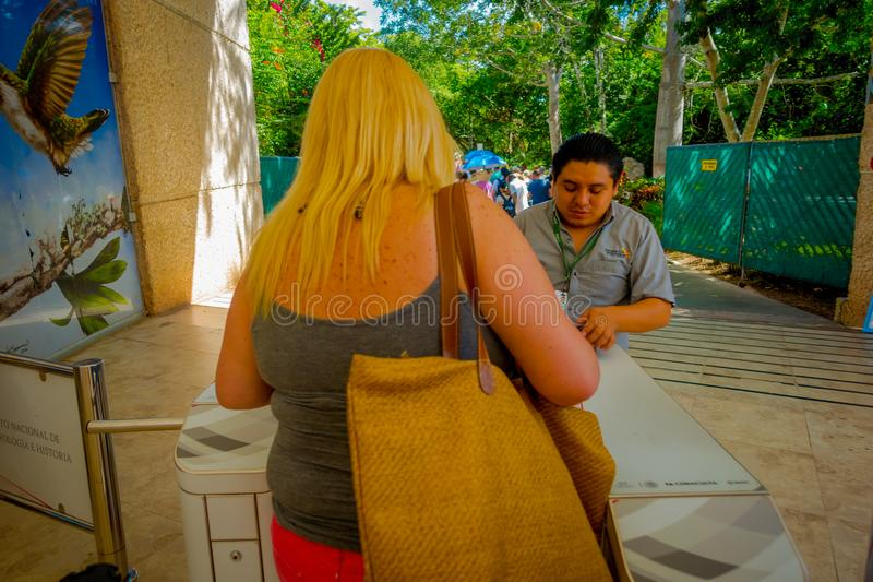CHICHEN ITZA, MEXICO - NOVEMBER 12, 2017: Unidentified woman giving the tickets to enter and visit at Chichen Itza ruins stock photography