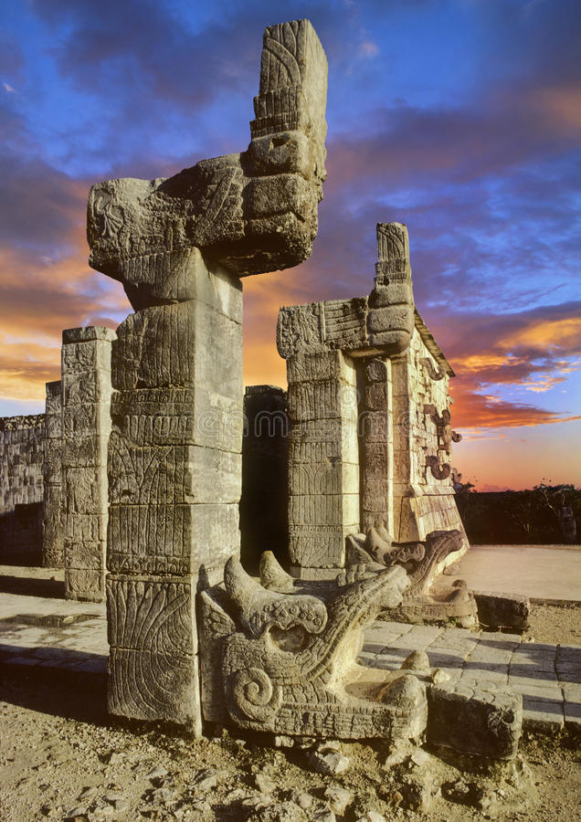 Chichen Itza stone sculptures on top of pyramid royalty free stock image
