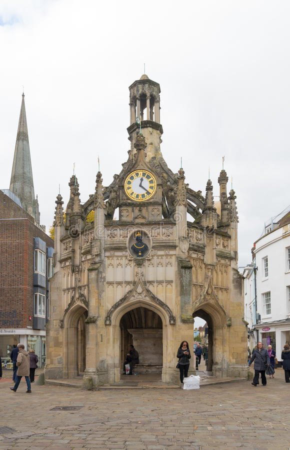 Chichester clock tower. CHICHESTER, ENGLAND - OCTOBER 22, 2015: Unknown people in front of the Chichester clock tower. Chichester is a cathedral city in West royalty free stock photography