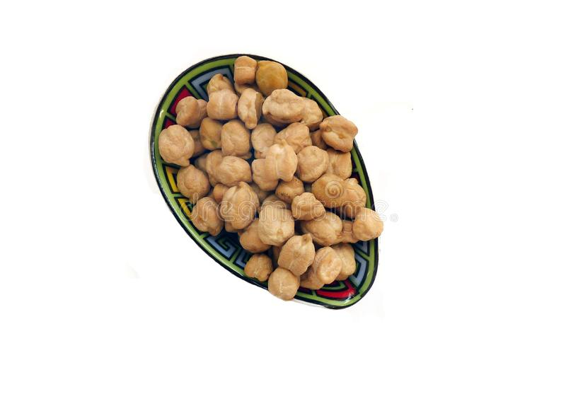 Chichpeas或豌豆在一块小美丽的板材 免版税库存照片