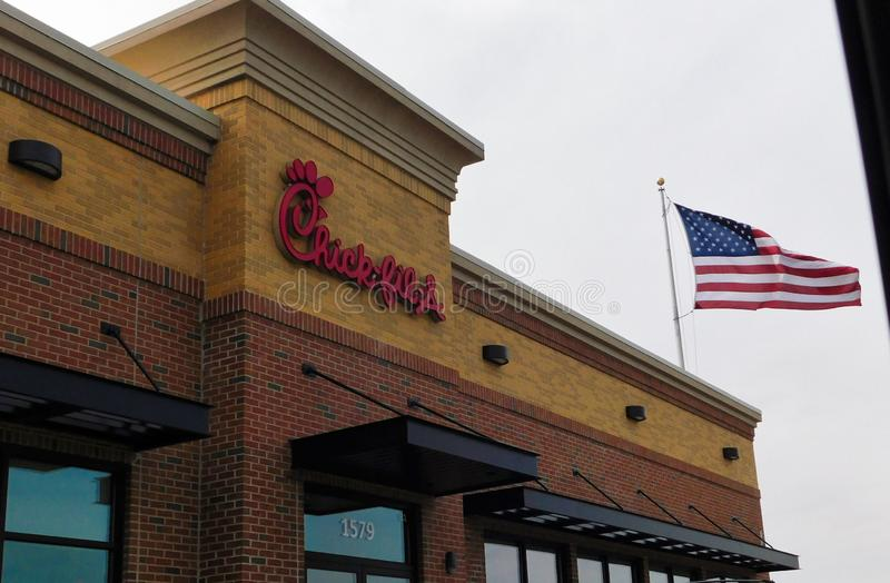 Chick-fil-A restaurant with American Flag stock image