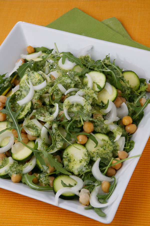 Chick pea, onion, rucola and zuchinni salad with d. Ressing on plate stock photos