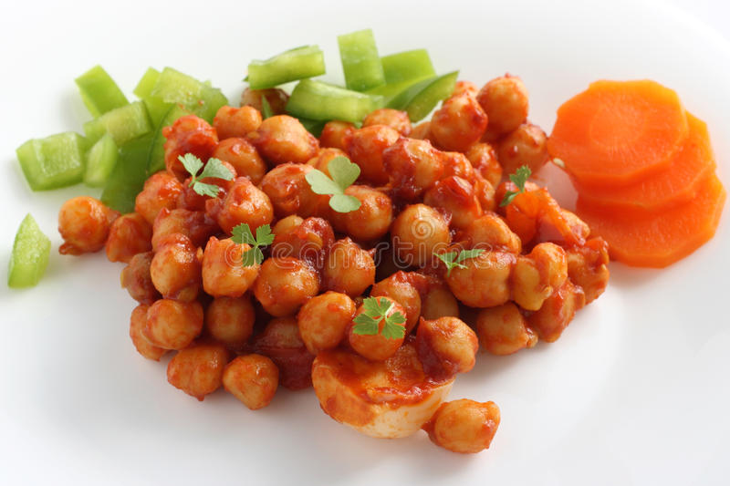 Chick-pea with tomato sauce royalty free stock photos