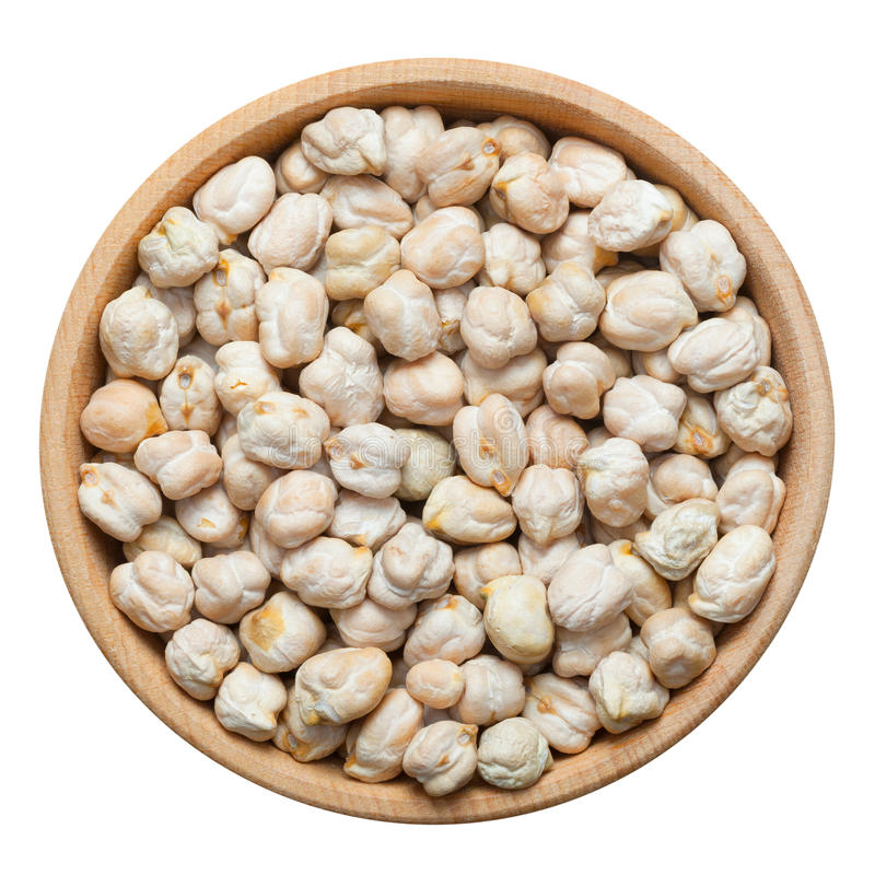 Chick peas in wooden bowl, isolated on white. Top view stock images