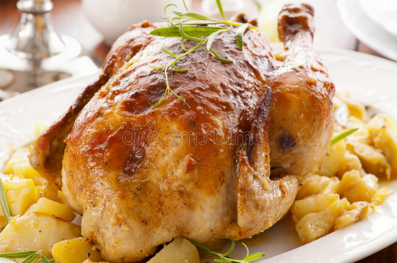 Chicken. Roasted with potato close up stock images