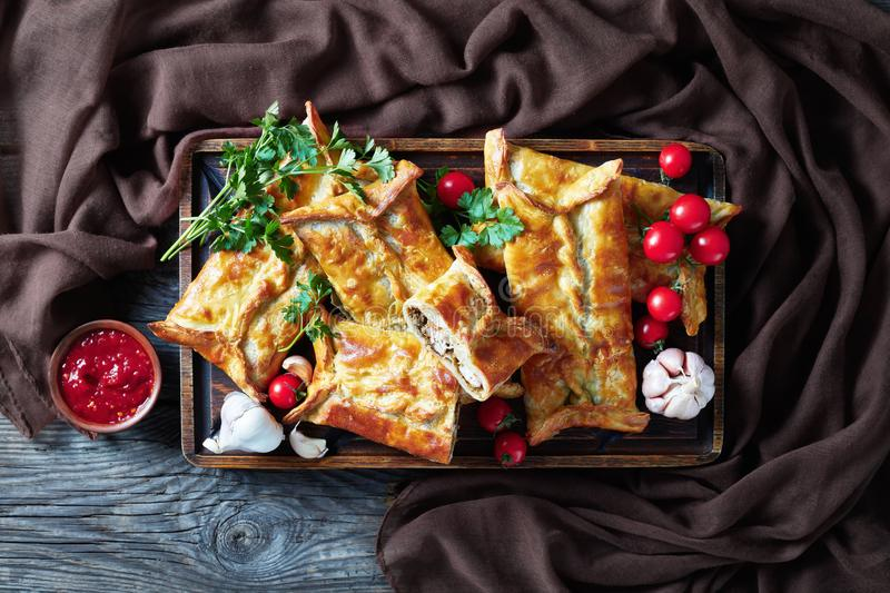 Chicken and baje sauce Stuffed Puff Pastry Borek. Chicken and ground walnut Stuffed Puff Pastry Borek,  Baked Chicken Pies, Puff Pastry Chicken Bundles on a stock images
