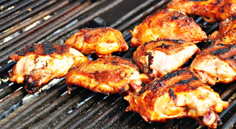 Chicken barbecue. On hot grill royalty free stock images