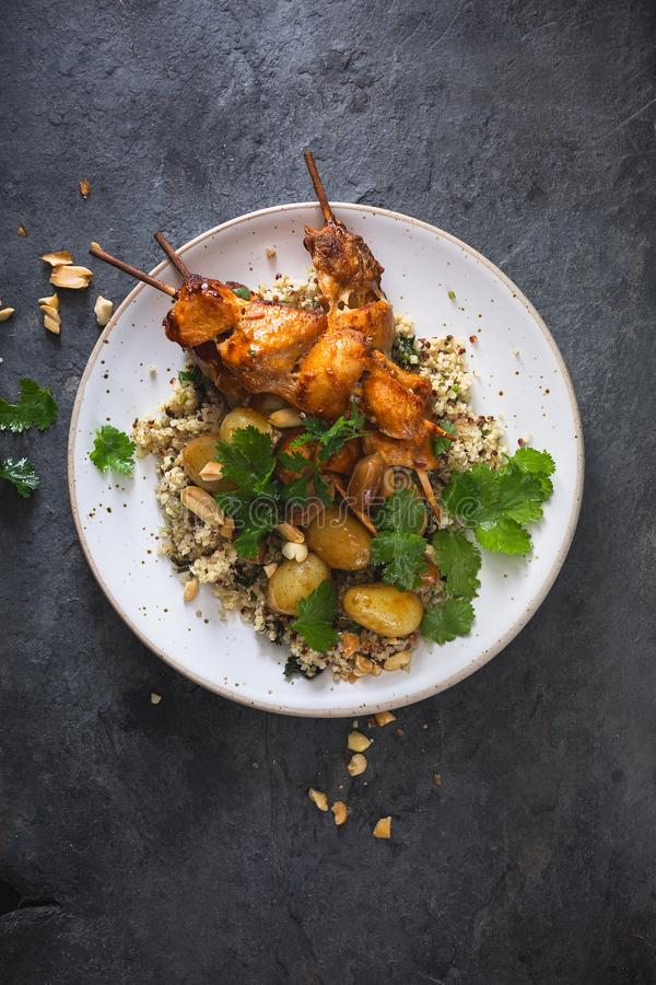 Chicken Barbecue Skewers with Quinoa and Potatoes royalty free stock photo