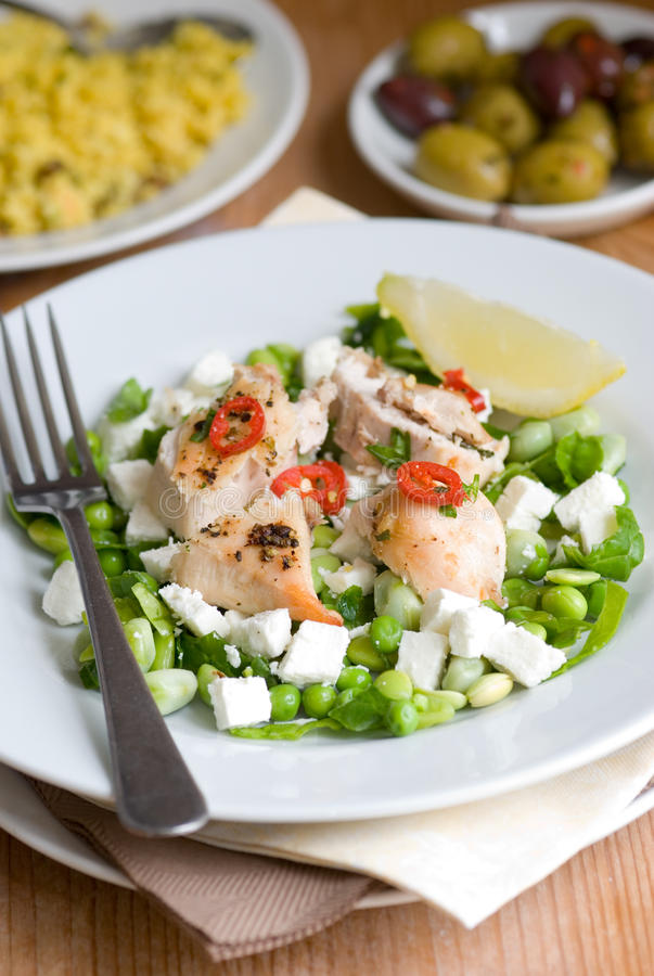 Chicken with beans and feta royalty free stock images