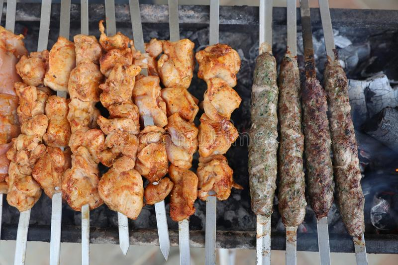 Chicken and Beef on Barbecue Grill stock photography
