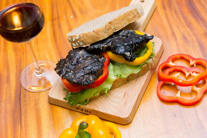 Chicken berger on table. Chicken berger and wine on wood dish royalty free stock photography