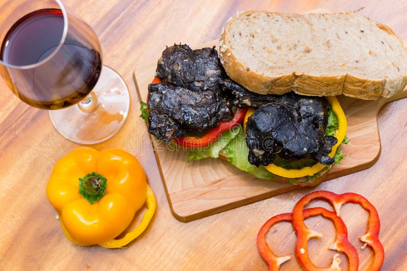 Chicken berger on table. Chicken berger and wine on wood dish royalty free stock photo