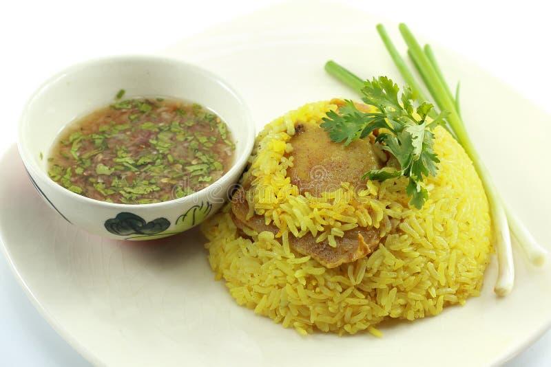 Chicken biryani. In plate on white stock photos