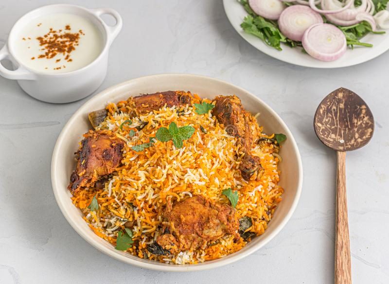 Chicken Biryani with Raita and Onion - One Pot Rice and Chicken Dish royalty free stock image