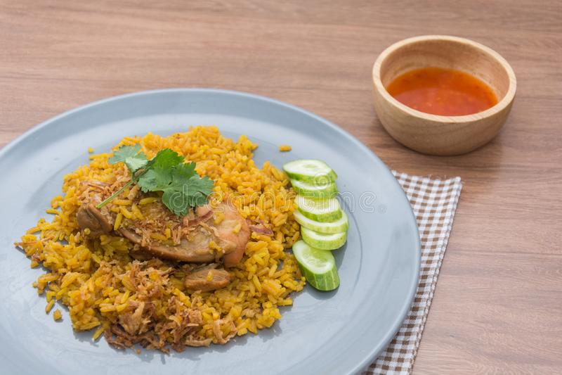 Chicken Biryani with rice and sauce. Halal food Khao Mok Gai royalty free stock photo