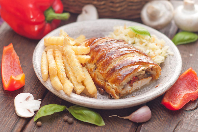 Chicken breast in a French pastry. stock images