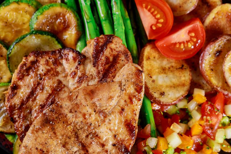 Chicken breast grilled with potato , zucchini and asparagus clouse up royalty free stock images