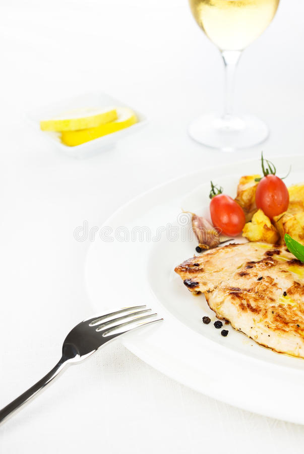 Chicken breast grilled with vegetables and spices stock photo