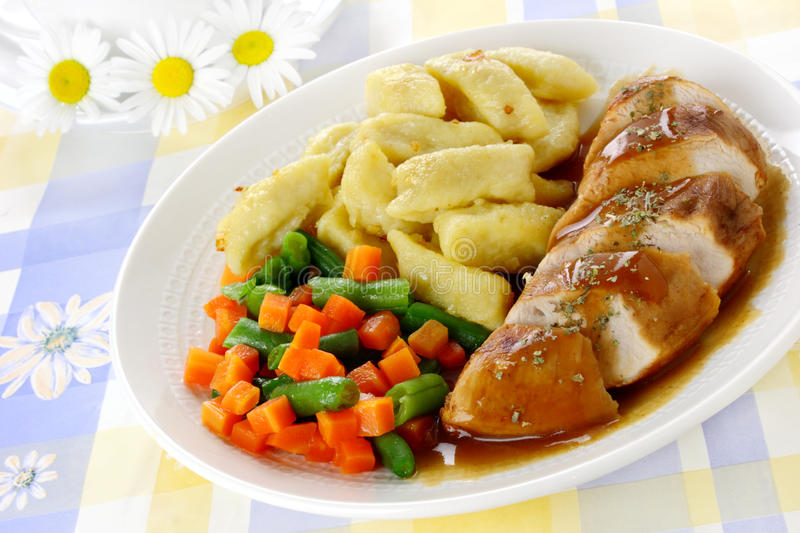 Chicken breast with potato dumplings. And vegetables royalty free stock photography