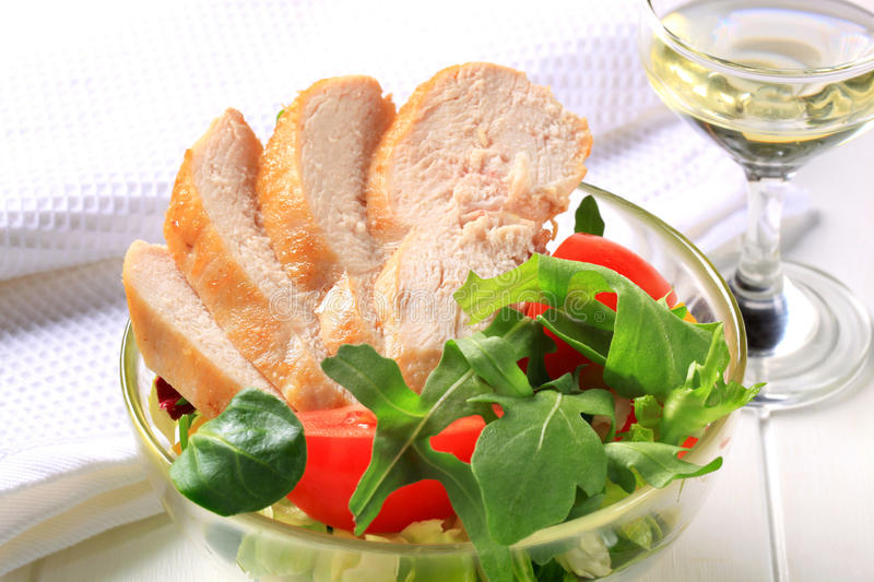 Chicken breast with salad greens royalty free stock images