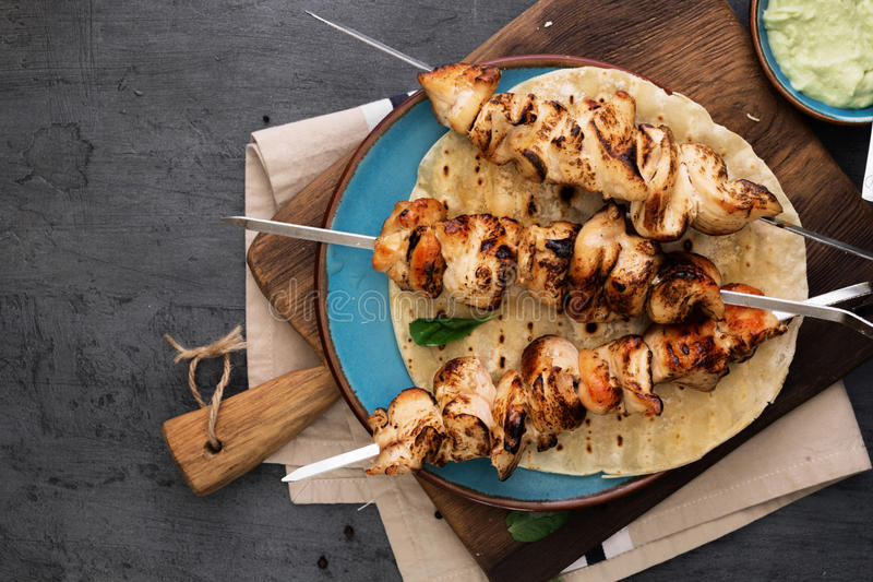 Chicken breast skewers with flatbread and avocado sauce royalty free stock images
