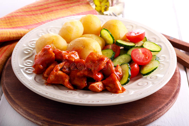Chicken breast in tomato sauce with potato royalty free stock image