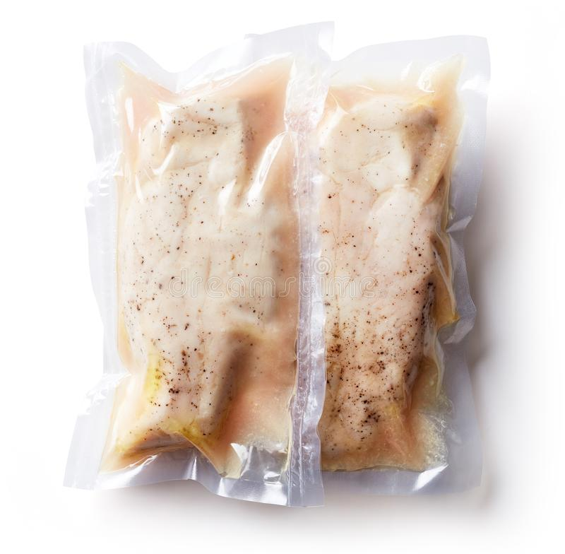Chicken breast vacuum sealed isolated on white, from above. Chicken breast vacuum sealed ready for sous vide cooking isolated on white background, top view stock photos