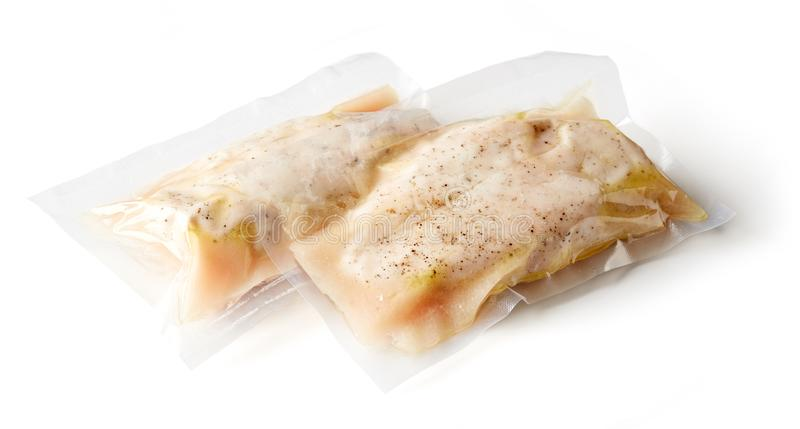 Chicken breast vacuum sealed isolated on white. Chicken breast vacuum sealed ready for sous vide cooking isolated on white background royalty free stock photos