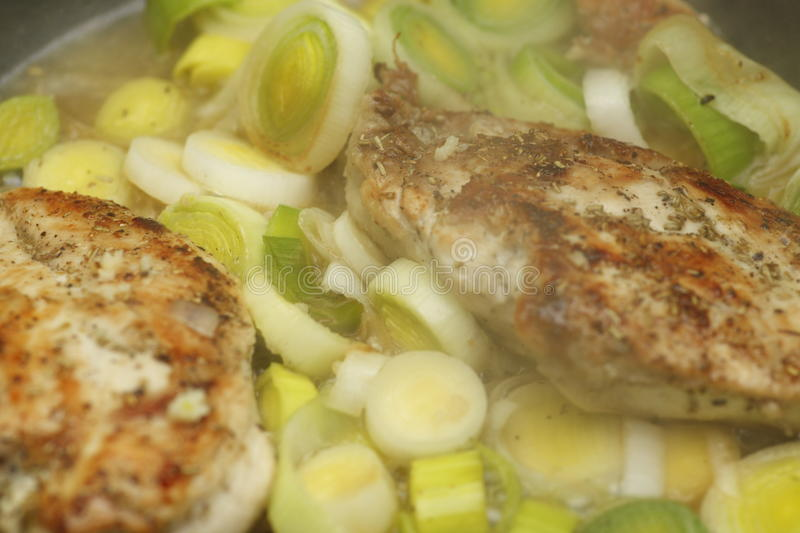Chicken Breasts and Leeks. Grilled chicken breasts on a bed of leeks royalty free stock photos