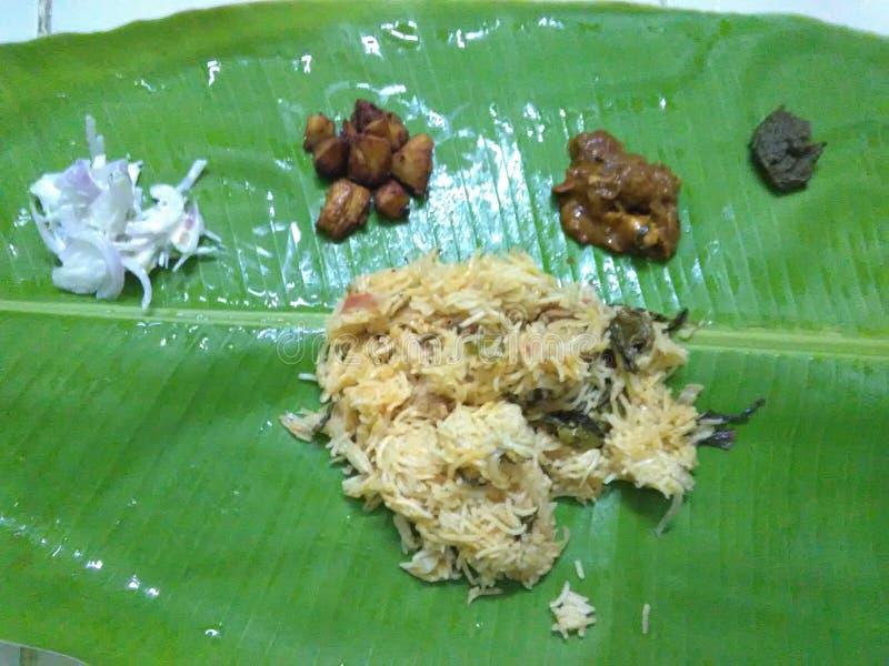 Chicken briyani, chicken gravy, chicken fry, raita, Pudina chutney served in traditional banana leaf royalty free stock photos
