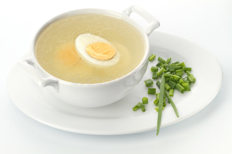 Chicken broth. Served place setting with chicken broth and croutons royalty free stock photography