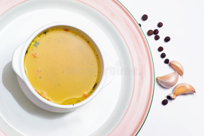Chicken broth. And pepper - close up stock photography