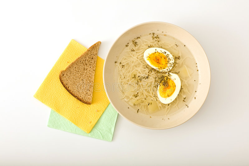Chicken broth. With hard-boiled egg royalty free stock image