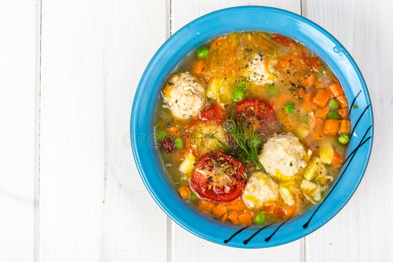 Chicken broth with vegetables and meatballs. Studio Photo stock images