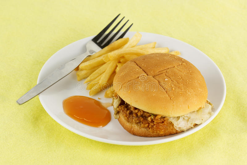 Chicken burger with french fried. Close up crispy chicken burger with french fried on the plate royalty free stock images