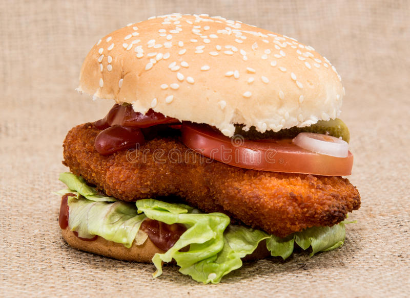 Chicken Burger on rustic background. (macro view stock photography