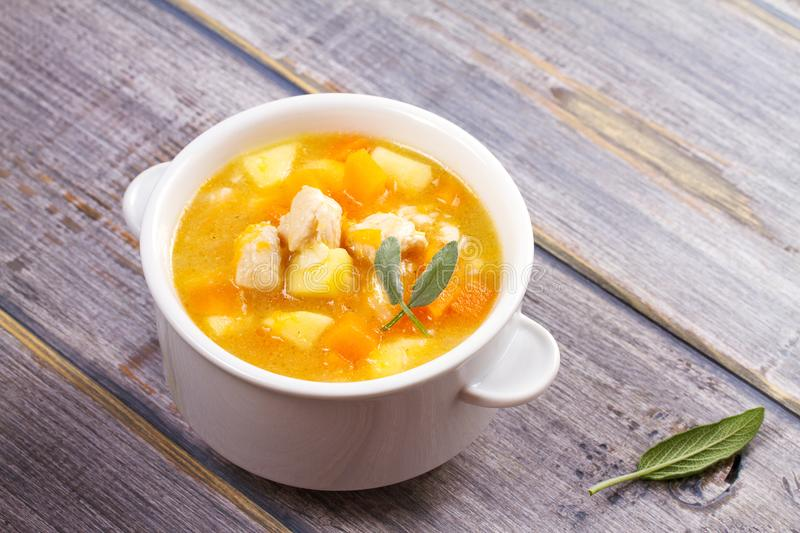 Chicken, butternut, apple ginger and sage stew. Pumpkin and chicken breast soup. Chicken, butternut, apple ginger and sage stew. Pumpkin and chicken breast soup royalty free stock photo