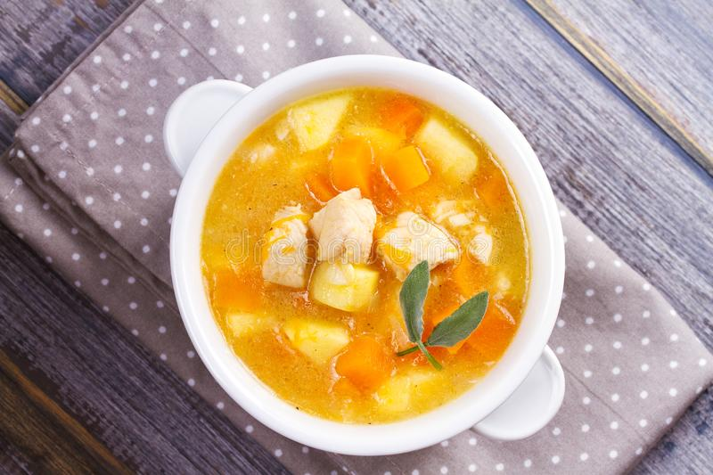 Chicken, butternut, apple ginger and sage stew. Pumpkin and chicken breast soup. View from above, top shot, horizontal royalty free stock images