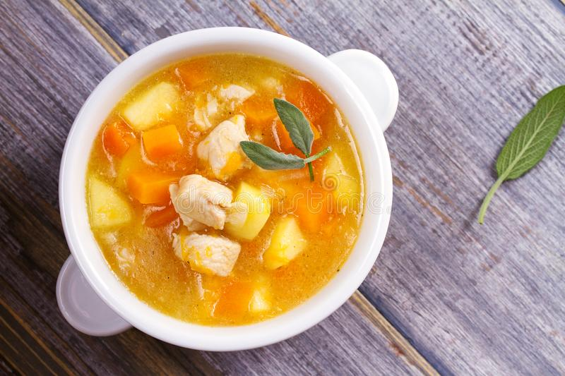 Chicken, butternut, apple ginger and sage stew. Pumpkin and chicken breast soup. View from above, top shot, horizontal stock photos