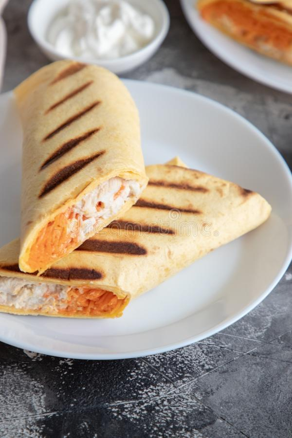 Chicken and carrot roll ups. Home made chicken and carrot roll ups for healthy breakfast or lunch stock image