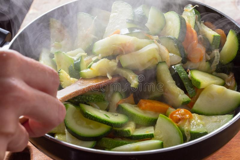 Chicken. carrot and zucchini on pan vegetable food,  stir royalty free stock photography