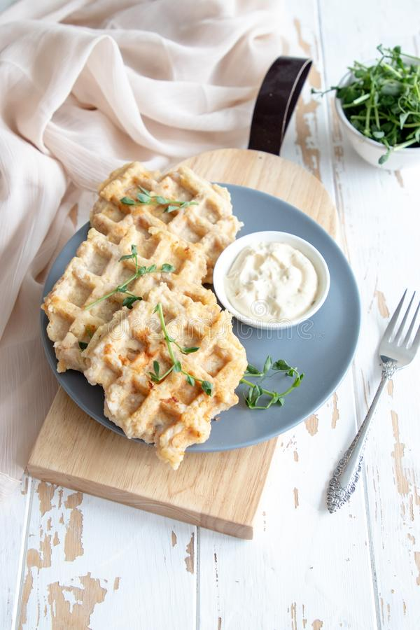 Chicken and cheese waffles with sour cream sauce royalty free stock photos
