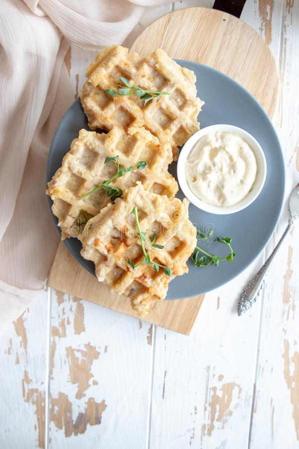 Chicken and cheese waffles with sour cream sauce royalty free stock image
