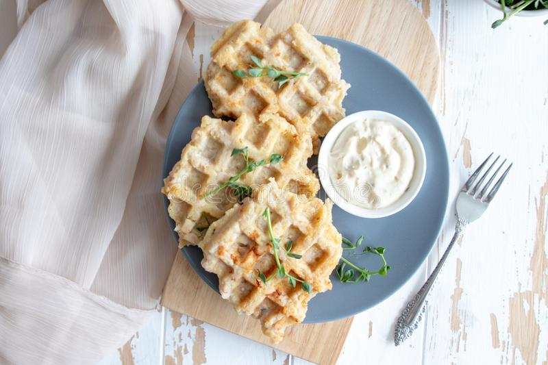 Chicken and cheese waffles with sour cream sauce royalty free stock photo