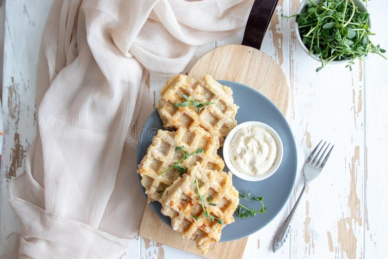 Chicken and cheese waffles with sour cream sauce stock photography